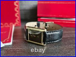 Must de Cartier Tank Mechanic 18ct Gold on Silver in very good cond unisex+box+